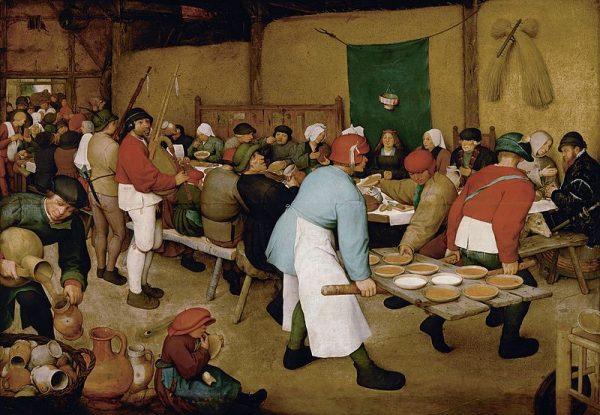 """Lordowie bogacili się także dzięki kontroli prywatnego życia swoich poddanych. Nie tylko mogli decydować o małżeństwach, ale i pobierali pieniężne kary za cudzołóstwo. Obraz Pietera Bruegla Starszego """"Chłopskie wesele""""."""