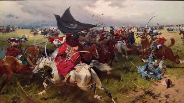 """Bogactwo husarskiego arsenału widać między innymi na obrazie Józefa Brandta """"Walka o sztandar turecki"""". W użyciu są kopia, czekan, szabla, w pogotowiu czekają pistolety."""